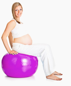 Pregannt lady balancing on a pilates ball
